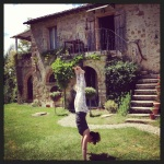 Charlie Speller, London & Swindon Forrest Yoga teacher in handstand at Forrest Yoga retreat Tuscany