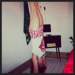 Charlie Speller Forrest Yoga teacher handstand in pyjamas